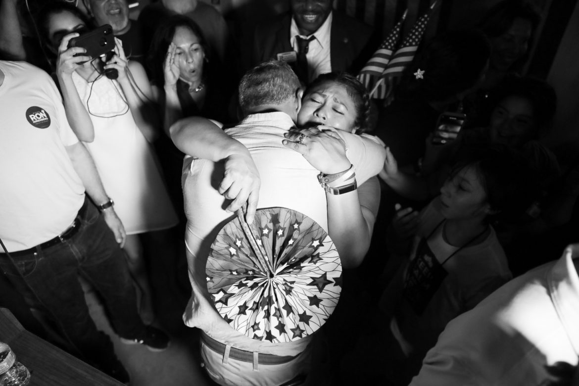 Mayor Ron Nirenberg and his wife Erika Prosper embrace at the end of election night.