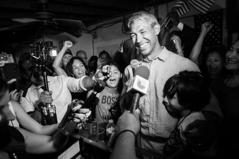 Along with supporters Mayor Ron Nirenberg celebrates his victory over challenger Greg Brockhouse.