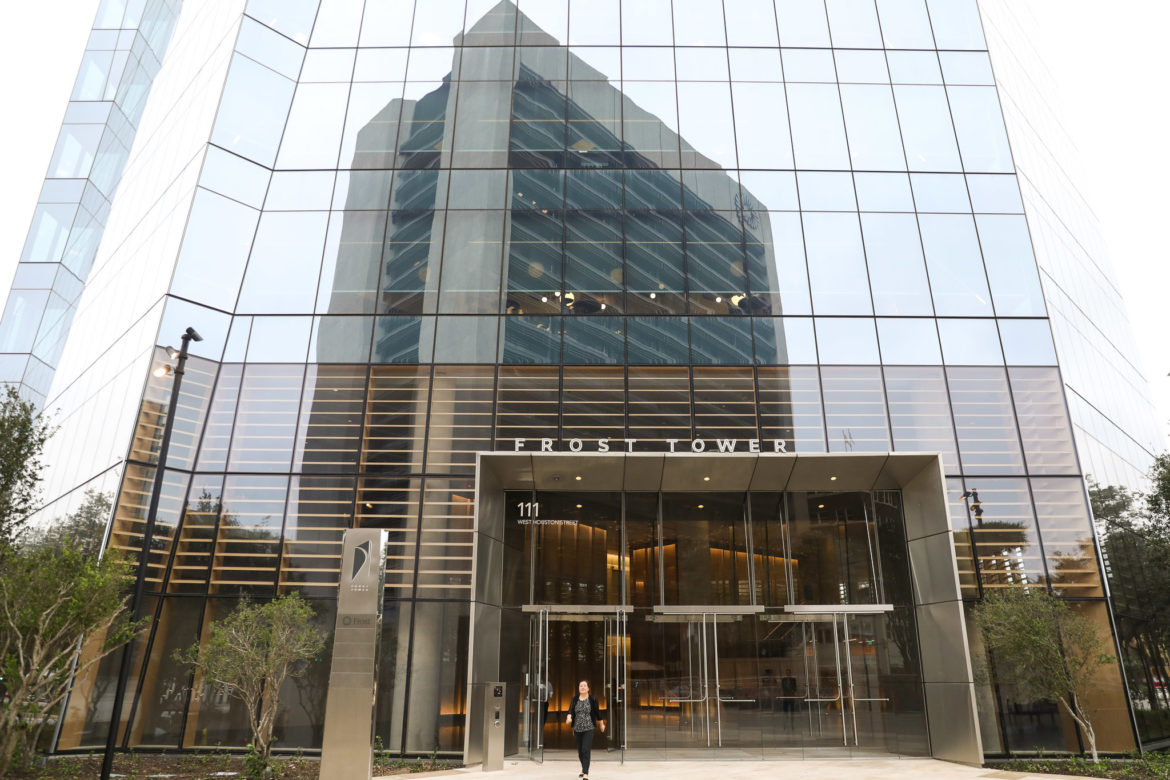 As construction at Frost Tower nears completion, workers trickle into the new downtown building.
