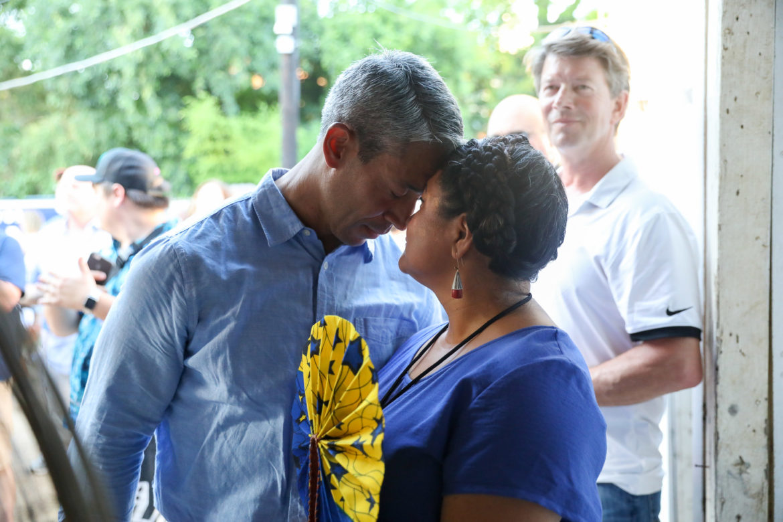 Incumbent Mayor Ron Nirenberg and wife Erika Prosper embrace at Nirenberg's Saturday night election watch party.