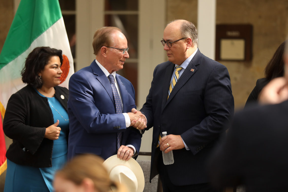 County Judge Nelson Wolff shakes hands with Senior Vice President and Co-Chairman of the Texas and Mexico Trade Coalition Eddie Aldrete during a press conference on North American trade.