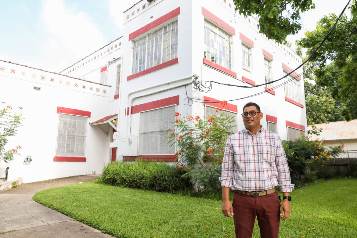 Luis Vargas stands in front of the House of Neighborly Service just across the street from where Vargas grew up.