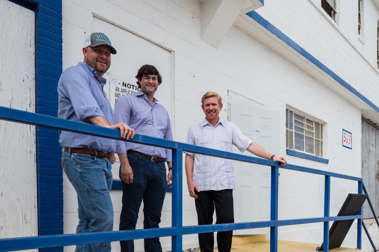 from left, Michael Johnson, Bobby Jones (center) and Ross Ormond (right) in front of the future sight of V!VA Beer TX.