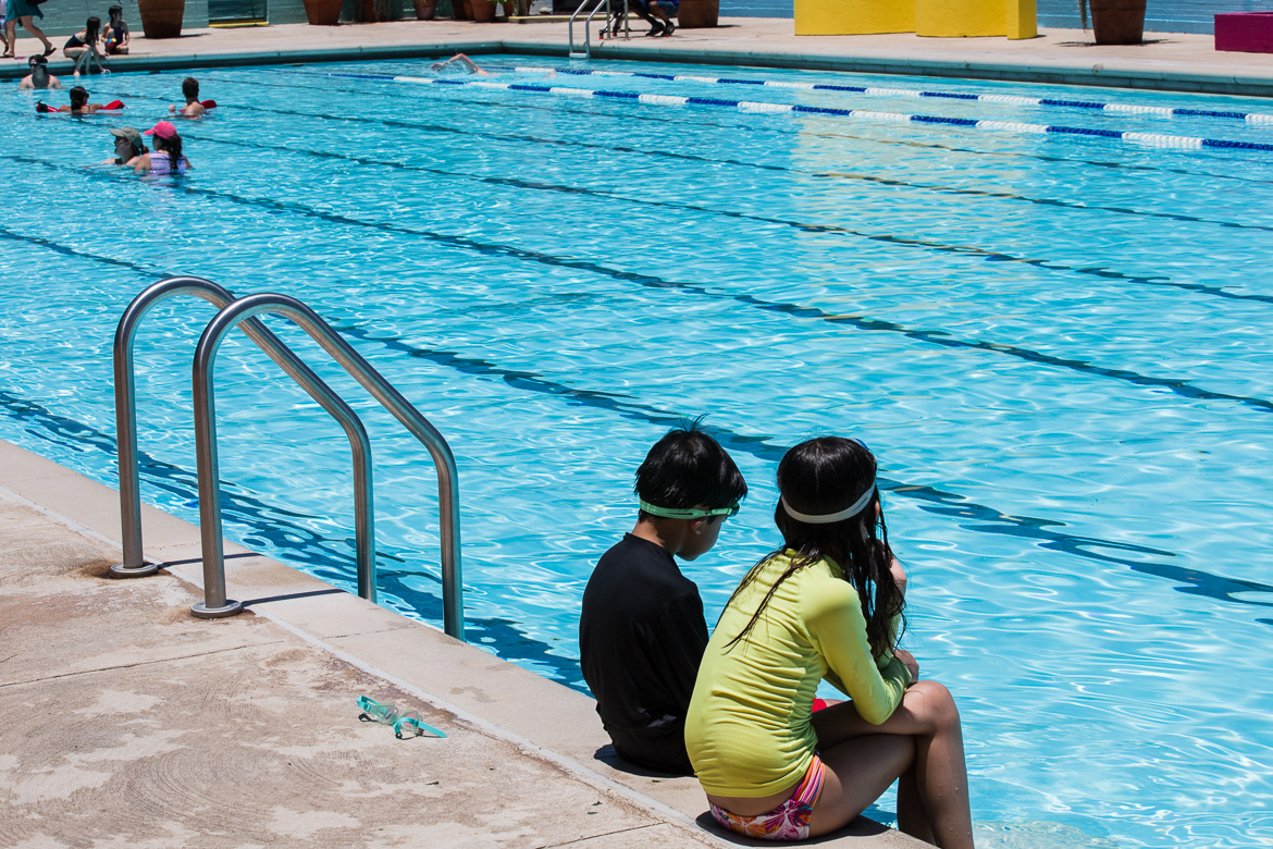 Kids waiting to swim at Alamo Heights Swimming Pool after the 10min break