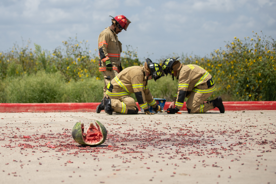 Firefighters demonstrate how to safely use fireworks this fourth of July behind a damaged watermelon ignited by a firework on June 28, 2019.