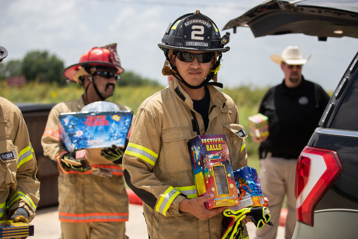 Firefighter A. Lantigua unloads fireworks to be used for the firework safety demonstration on June 28, 2019.