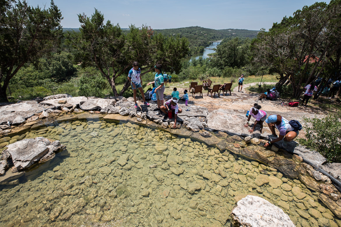 Camp Founder Girls rest and cool off at the springs on top of Inspiration Point on June 19, 2019.