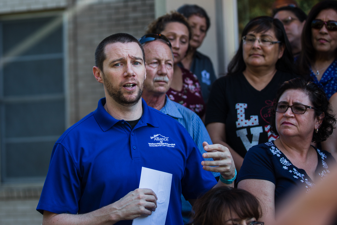 Teacher Luke Amphlett address the crowd with the San Antonio Alliance of Teachers and Support Personnel on June 17, 2019