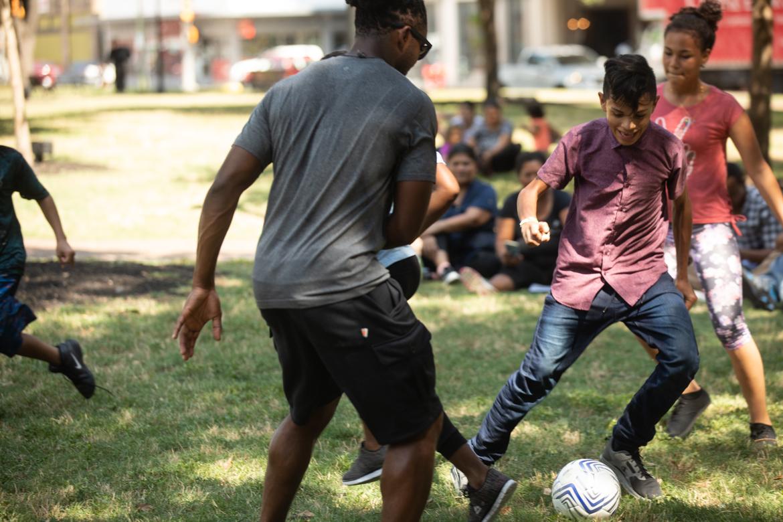 Freddy Yoel Orellana Peraza, right, tries to move the soccer ball past San Antonio Football Club captain Michael Lahoud, left.