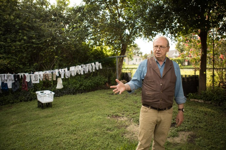 Tom Wetzler stands in front of his clothing line.