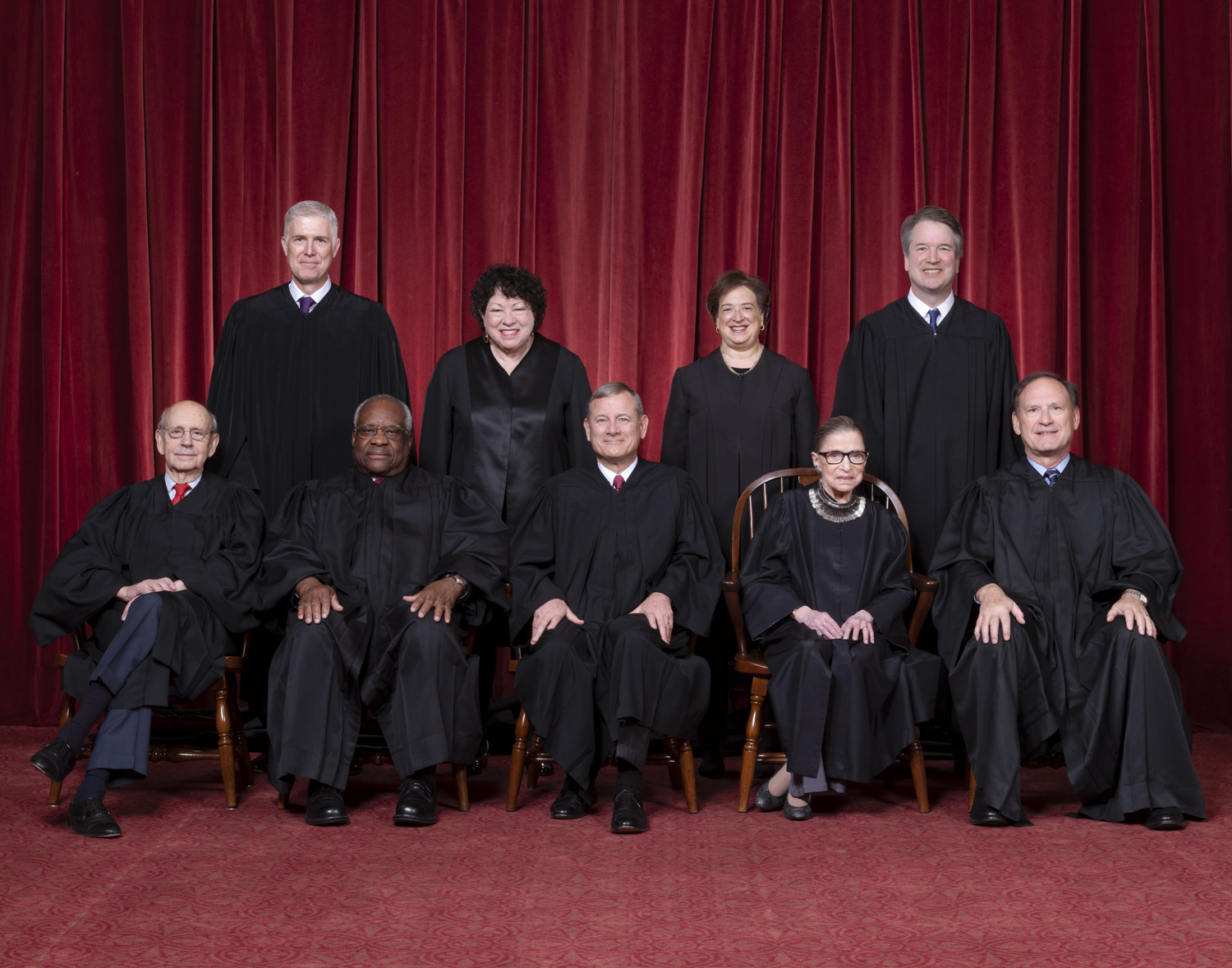 The Roberts Court, November 30, 2018. Seated, from left to right: Justices Stephen G. Breyer and Clarence Thomas, Chief Justice John G. Roberts, Jr., and Justices Ruth Bader Ginsburg and Samuel A. Alito. Standing, from left to right: Justices Neil M. Gorsuch, Sonia Sotomayor, Elena Kagan, and Brett M. Kavanaugh. Photograph by Fred Schilling, Supreme Court Curator's Office.