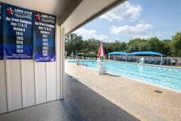 The Deerfield swimming pool displays the Deerfield Dragons swim team's championship years.