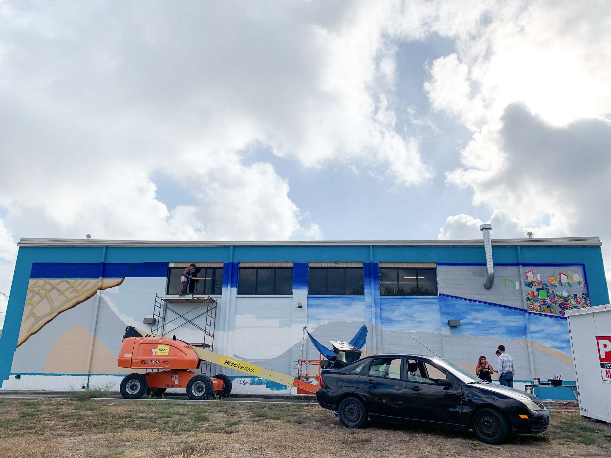Local artists continue work on a road safety awareness mural on the side of Fire Station #26 at 4140 Culebra Rd.