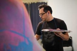 Joe De la Cruz paints his craneos in a Southtown studio.