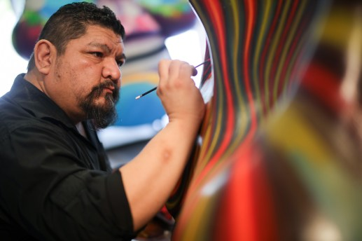 Artist Alex Rubio paints a detail of his Craneos project in his Southtown studio.