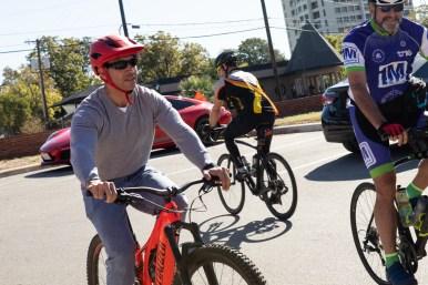 Mayor Ron Nirenberg (left) warms up on his bicycle.