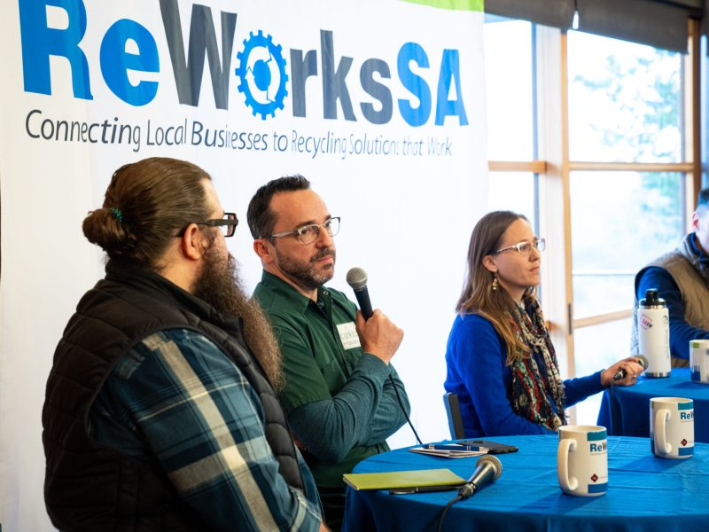 From left, panelists Chris Edwards, Steve McHugh, Kate Gruy Jaceldo, and Eric Cooper speak at a panel organized by the City's Solid Waste Management Department.