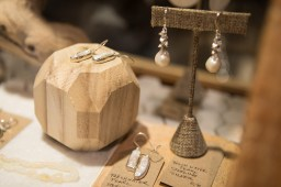 Jewelry is on display at GOOD Goods.