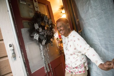 Spurs usher Olivia Ladson's walks out of her front door, which displays a Spurs wreath made for her by a friend.