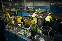 Republic Services employees line belts of removed contaminants from recycled material.