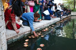 Diwali attendees participate in a diya ceremony as floating candles are placed into the the San Antonio River.