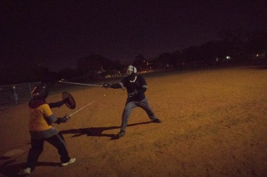 Don Duplan, who goes by Issac, (left) and Andrew Heinrich, who goes by Mateo, practice rapier combat.