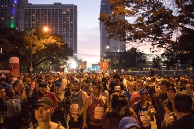 Rock 'n' Roll San Antonio half-marathon participants line up on East Market Street before the race begins.