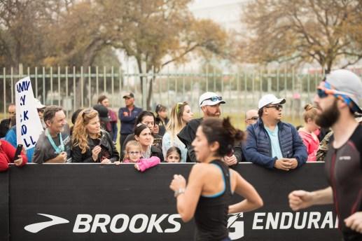 Runners reach the finish line of the half-marathon.