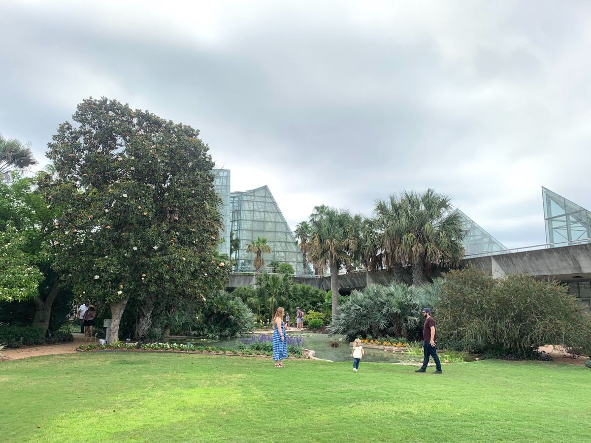 A family plays in open space at the San Antonio Botanical Garden, which opened Sunday under new safety protocols to reduce the spread of the coronavirus.