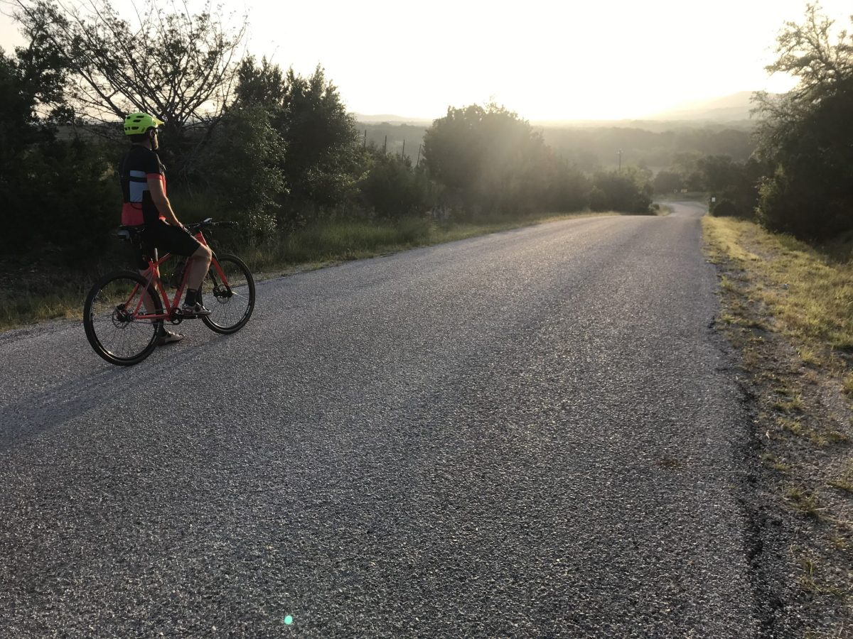Light from a Hill Country sunrise hits cyclist Jeff Coyle on a ride near Pipe Creek.