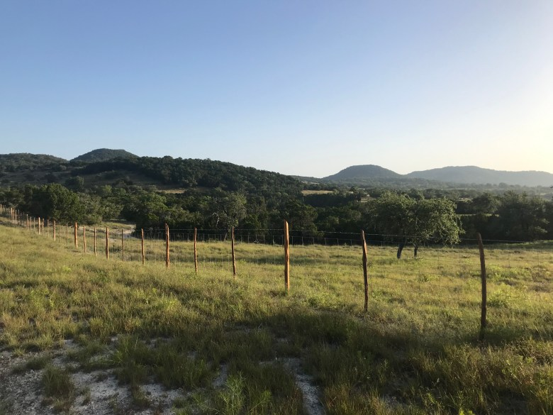 Rural county roads offer routes alongside private ranches in the Hill Country, like this one near Pipe Creek.
