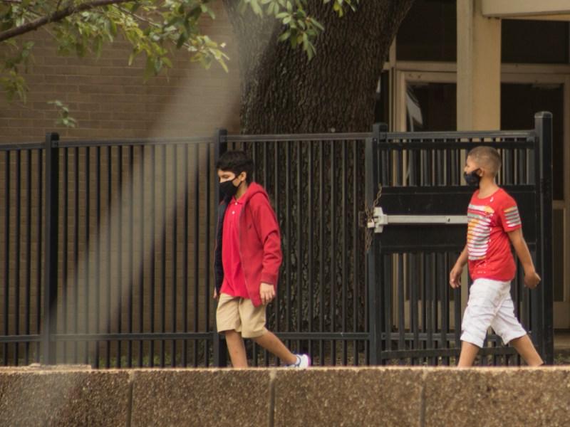 SAISD's Davis Middle School students leave school on Sept. 9.