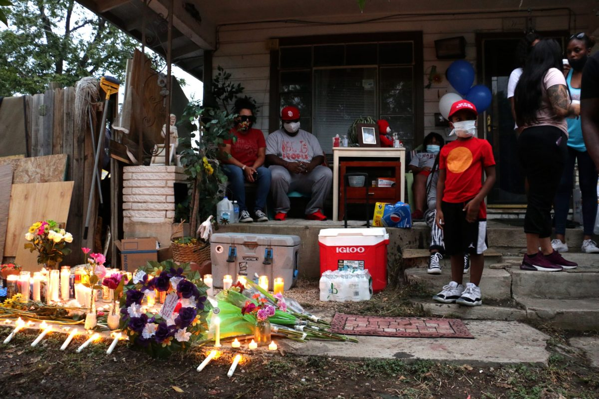 Darrell Zemault Sr.'s grandson and family gather on the front steps of his home of 25 years