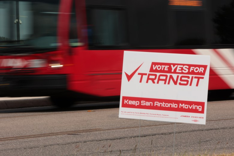 A campaign sign displays support for Proposition A, a measure to fund VIA expansion with sales tax revenue.