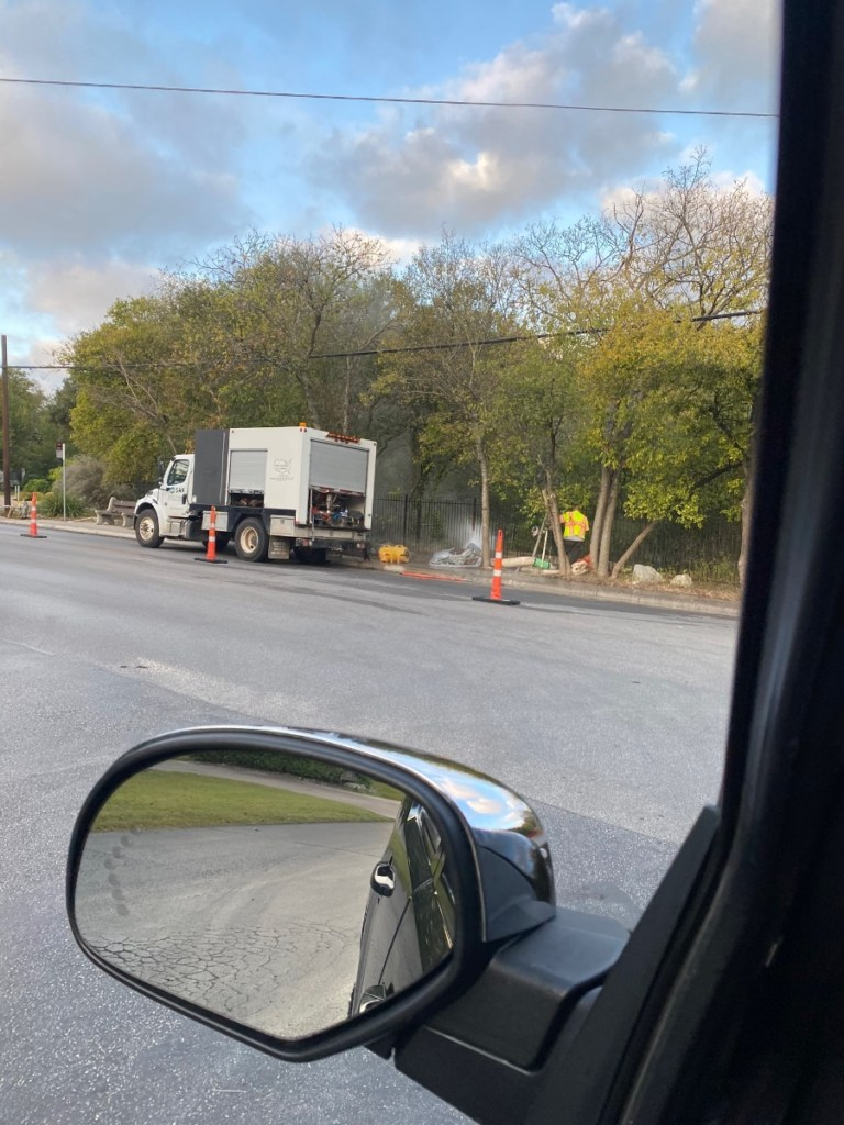 A photo taken Nov. 7, 2020, from across Nacogdoches Street from the Robber Baron Cave preserve shows a SAK Construction truck and worker.