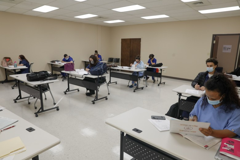 Students at Restore Education's CNA (certified nursing assistant) program work in class.
