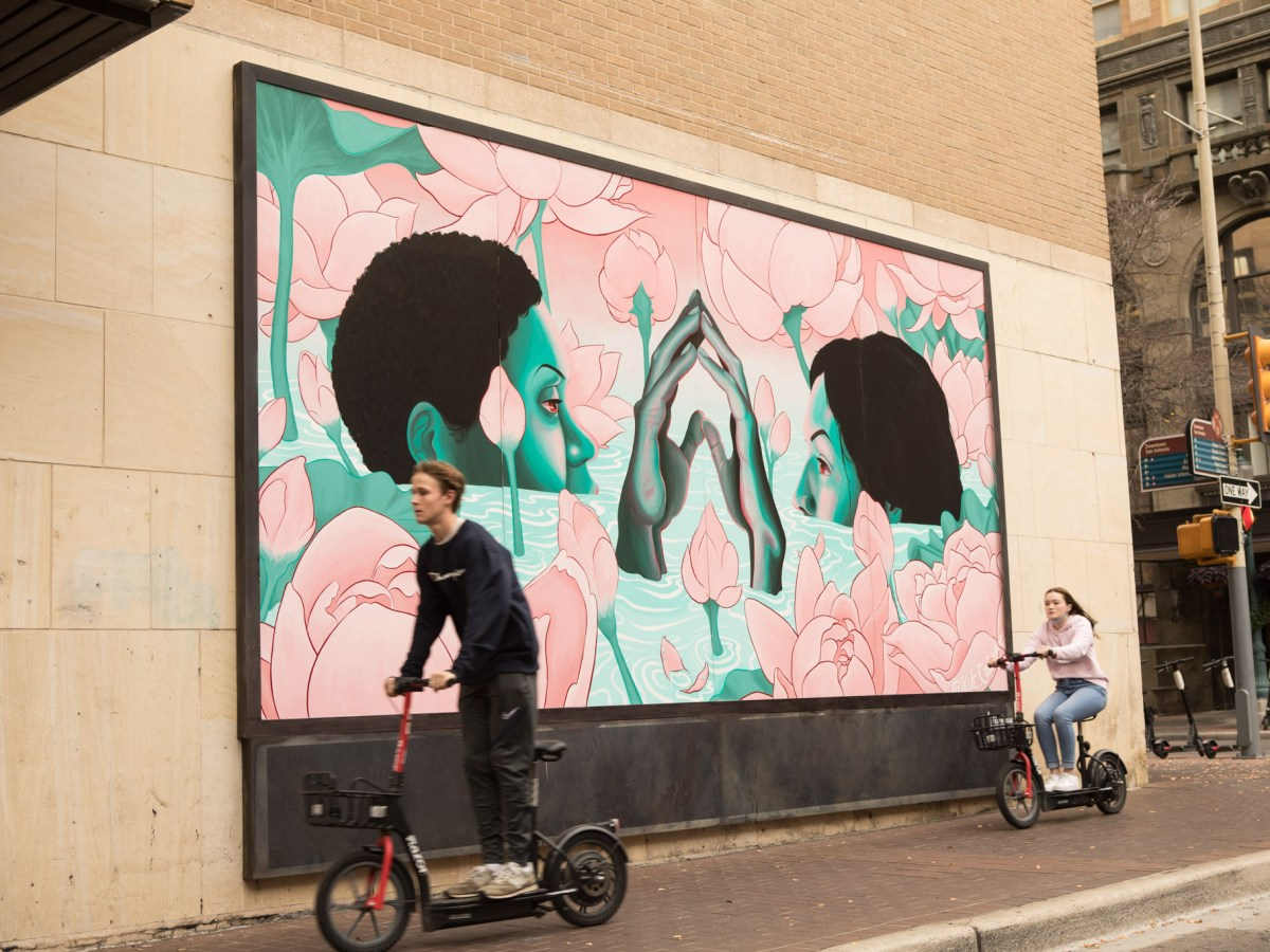 """""""And yet, we bloom"""" mural by Kat Cadena was installed at the intersection of East Houston Street and Navarro Street."""