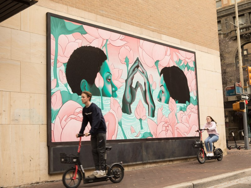 """And yet, we bloom"" mural by Kat Cadena was installed at the intersection of East Houston Street and Navarro Street."