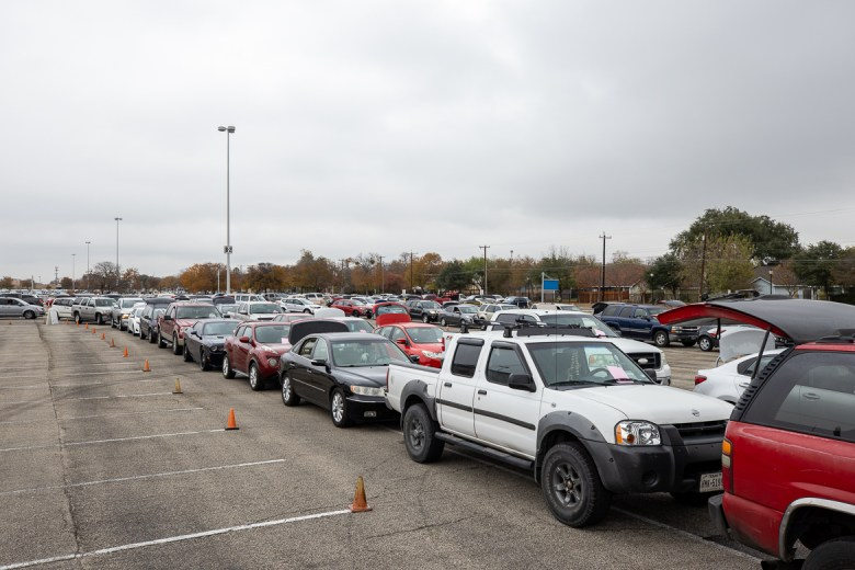 Hundreds of cars line up Friday at the Alamodome for the San Antonio Food Bank's largest food distribution event of the holiday season.