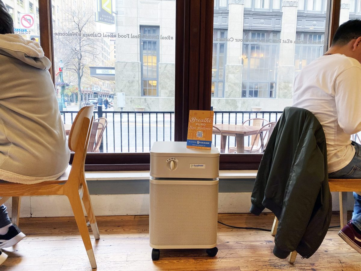 A Breathe Puro machine sits in between two tables at La Panaderia.