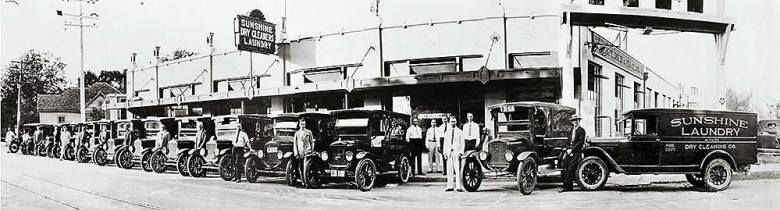 Model T vans owned by Sunshine Dry Cleaners & Laundry are lined up in front of the business in 1927.