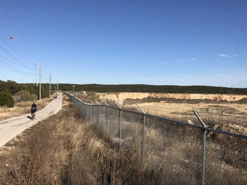 The first mile of Salado Creek Greenway trail south of Eisenhower Park threads between Camp Bullis and a former quarry owned by Martin Marietta.