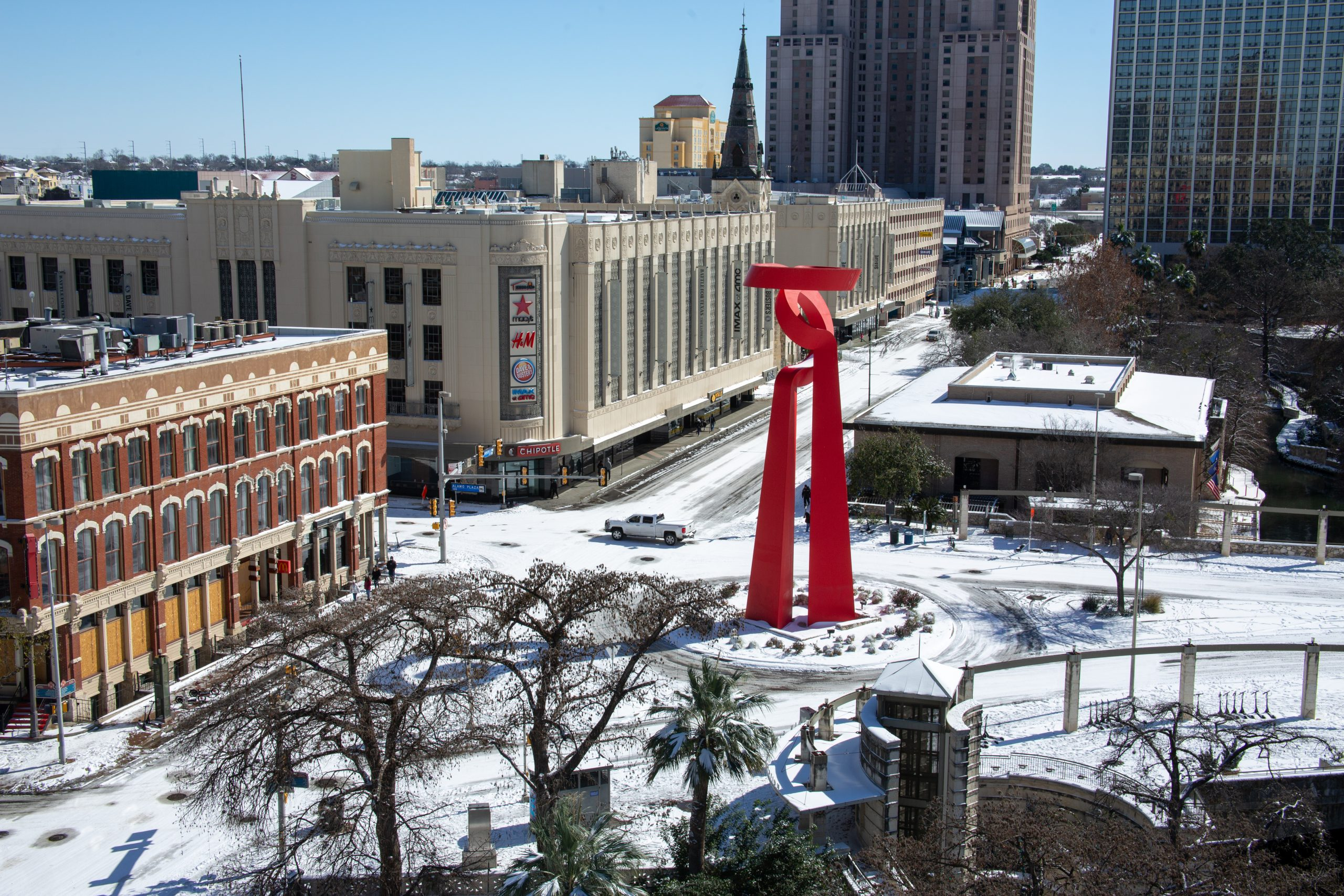The Torch of Friendship and the Shops at Rivercenter in downtown San Antonio are seen following an overnight winter storm on Monday.