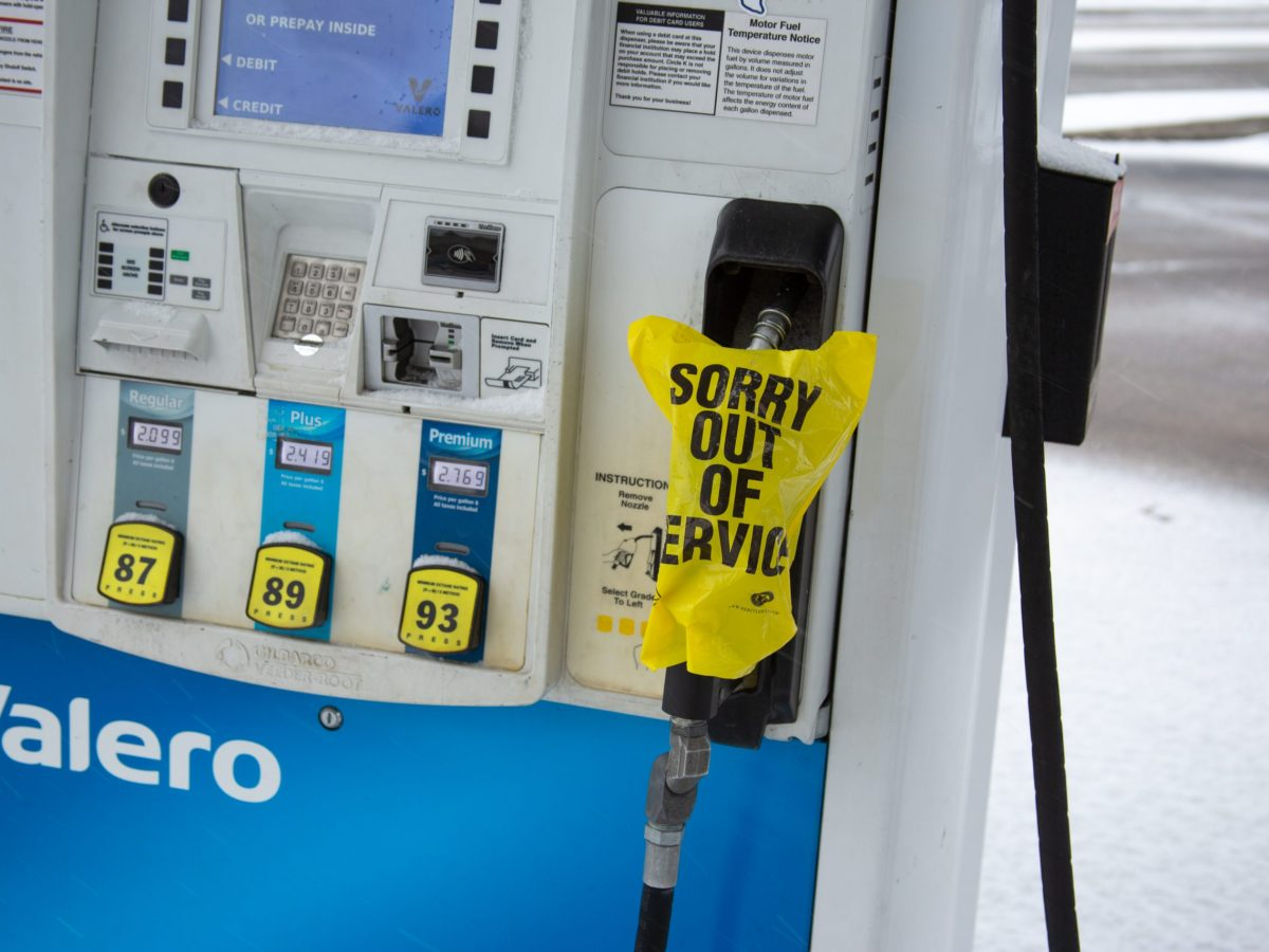 "Bags tied around the fuel pumps at the Valero gas station at the intersection of New Braunfels Avenue and I-35 read ""SORRY OUT OF SERVICE."" Photos taken during winter weather and snow on February 18, 2021."