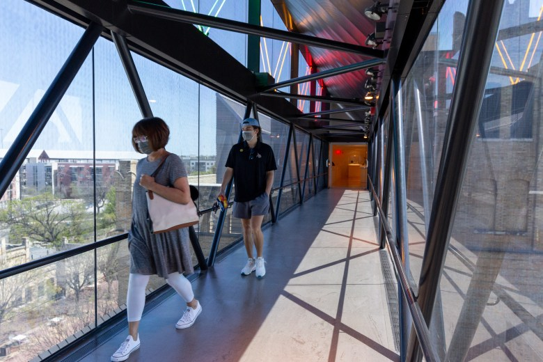 Visitors at the San Antonio Museum of Art walk across the sky bridge between the two wings of the museum. March 2021 marked the 40th anniversary of the museum.