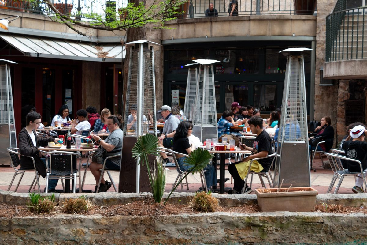 Visitors to the San Antonio River Walk dine outside in March.