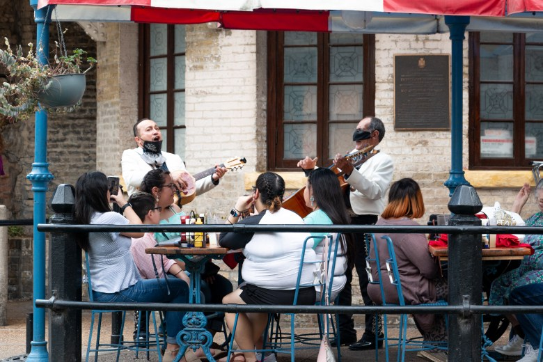 A mariachi band performs for a group of people dining at a restaurant on the San Antonio Riverwalk. Each restaurant and bar can make their own policies regarding mask-wearing and social distancing that patrons are encouraged to comply with. Tuesday, March, 16, 2021.