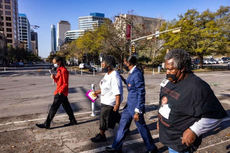 Pharaoh Clark walks with the family of police brutality victims as they make their way to the Texas Capitol Building to provide testimony for the George Floyd Act on Thursday, March 25, 2021.