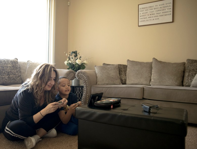 Iris Nuno plays Mario Kart with her 6-year-old son, Jared, at their home on Saturday in San Antonio.