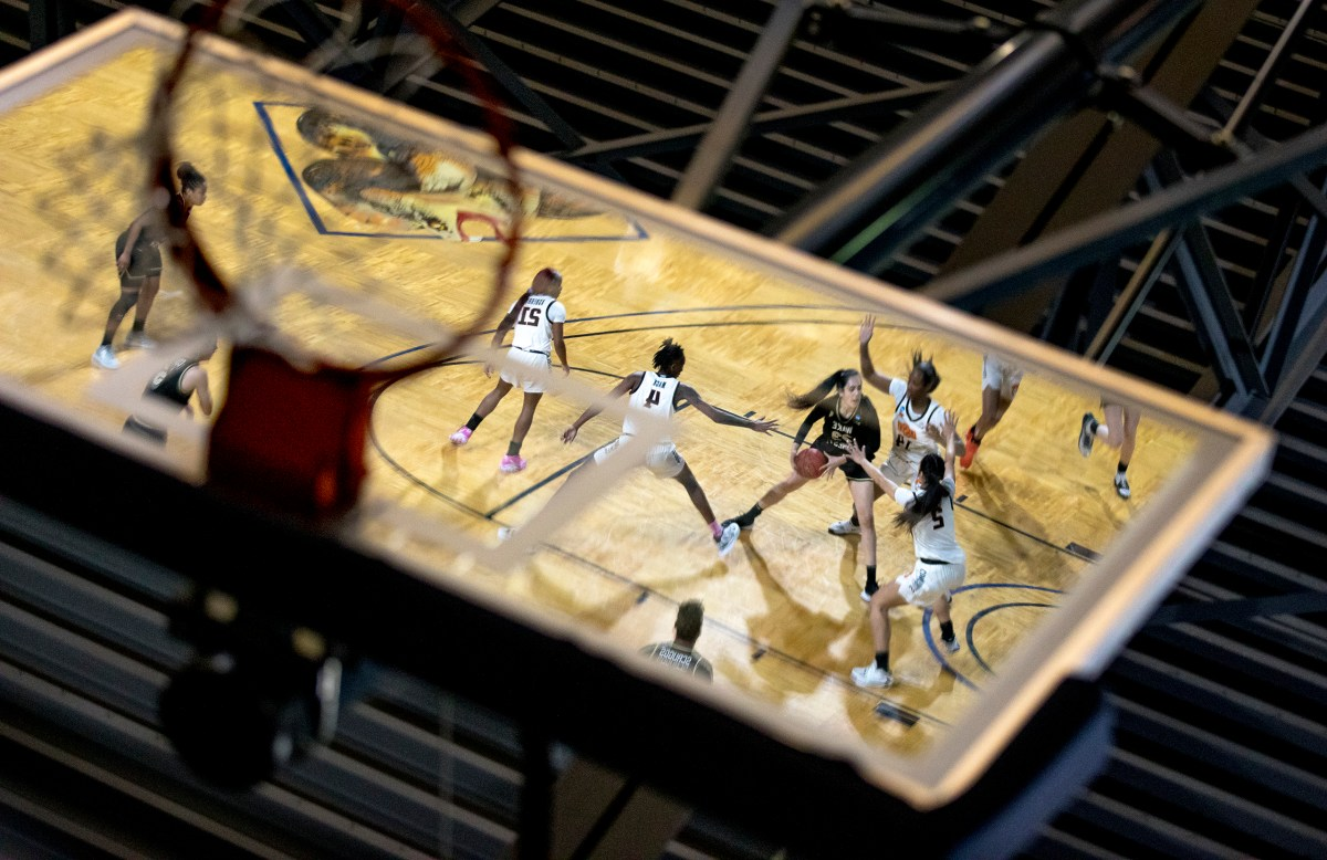 Reflected on a basketball backboard, Wake Forest forward Christina Morra (23) drives to the hoop against Oklahoma State forward Taylen Collins (14) during a college basketball game in the first round of the women's NCAA tournament at St. Mary's University on Sunday in San Antonio.